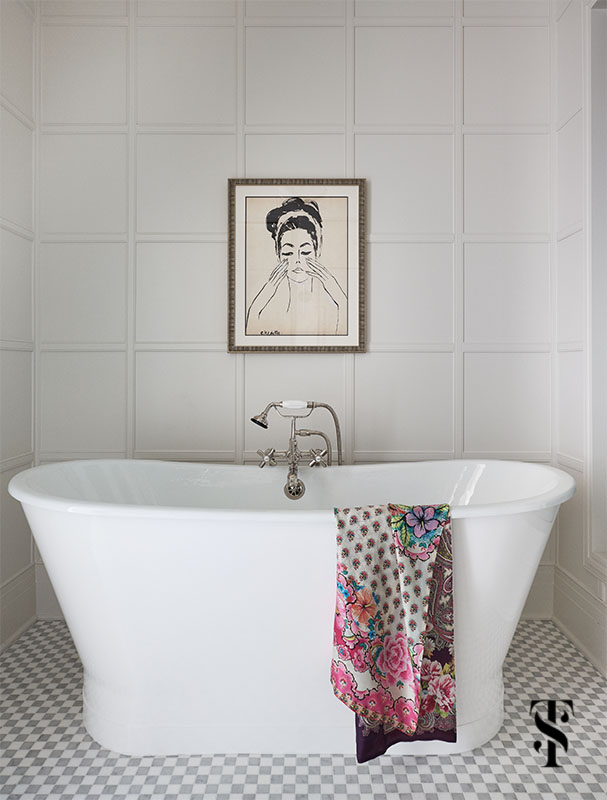 A beautiful soaking tub in a white paneled bathroom designed & remodeled by Summer Thornton. For more photos and information visit www.SummerThorntonDesign.com