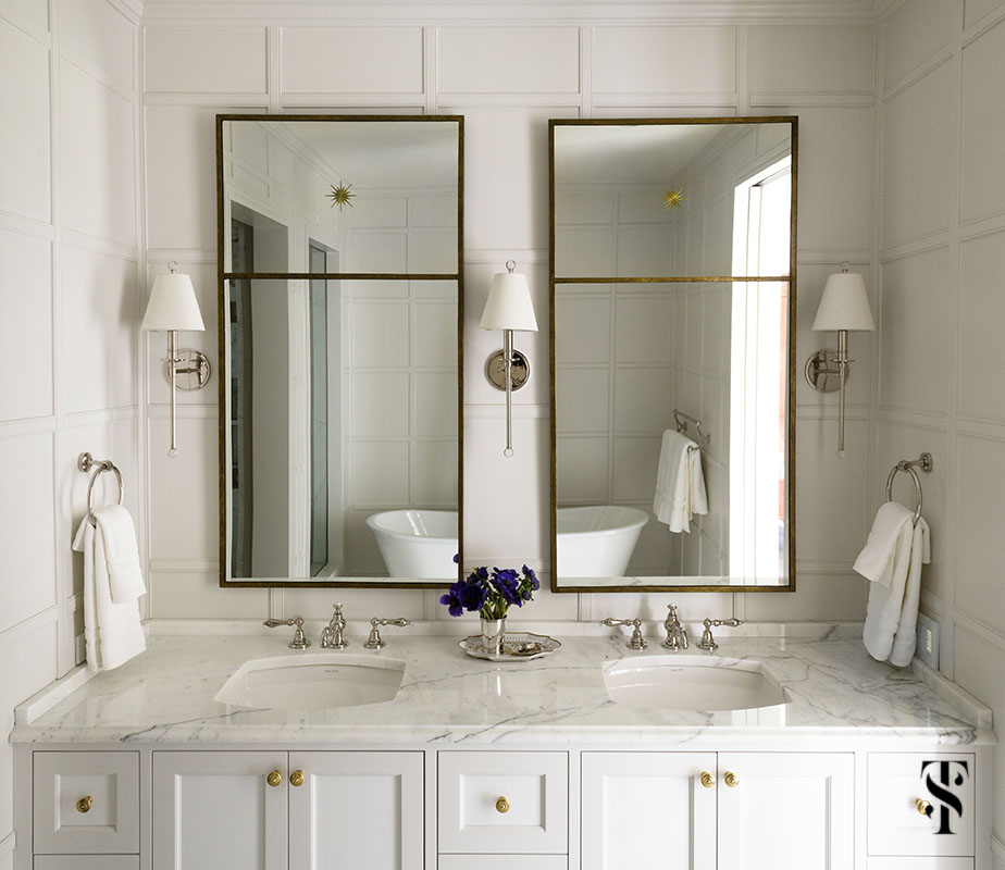 classic dream bathroom designed by Summer Thornton with white paneling, soaking tub, and waterworks faucetry - visit www.SummerThorntonDesign.com for more photos.