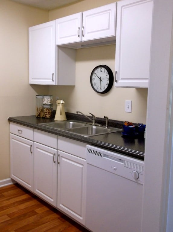 Functional galley kitchen with classic black-and-white color scheme