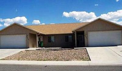 Ranch-style duplex under a blue sky