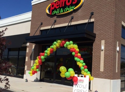 front of Petros store, with balloons for grand opening
