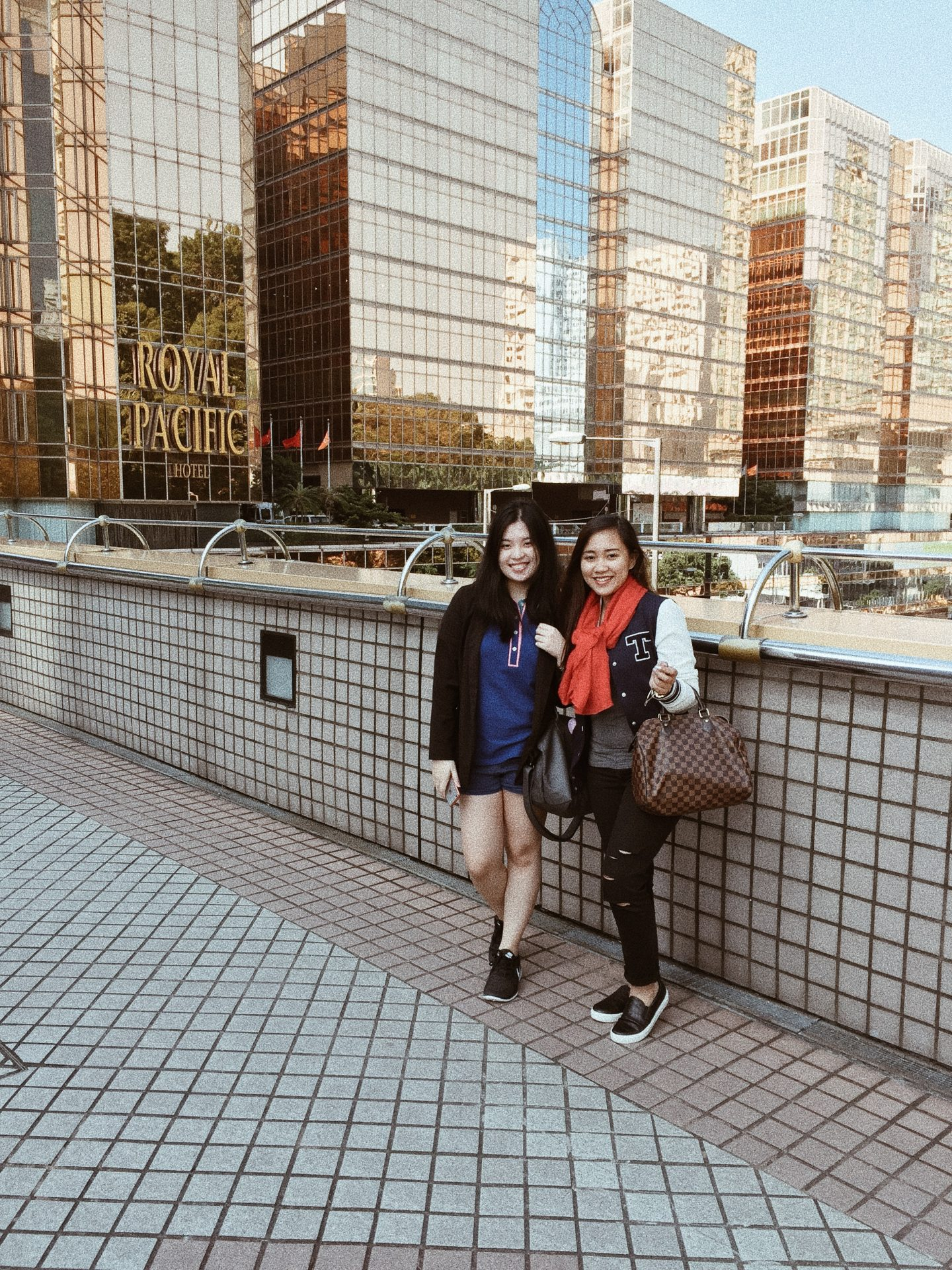 two girls in front of golden hotel hong kong