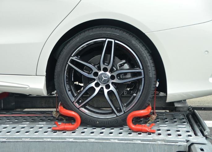 who pays for towing after an accident