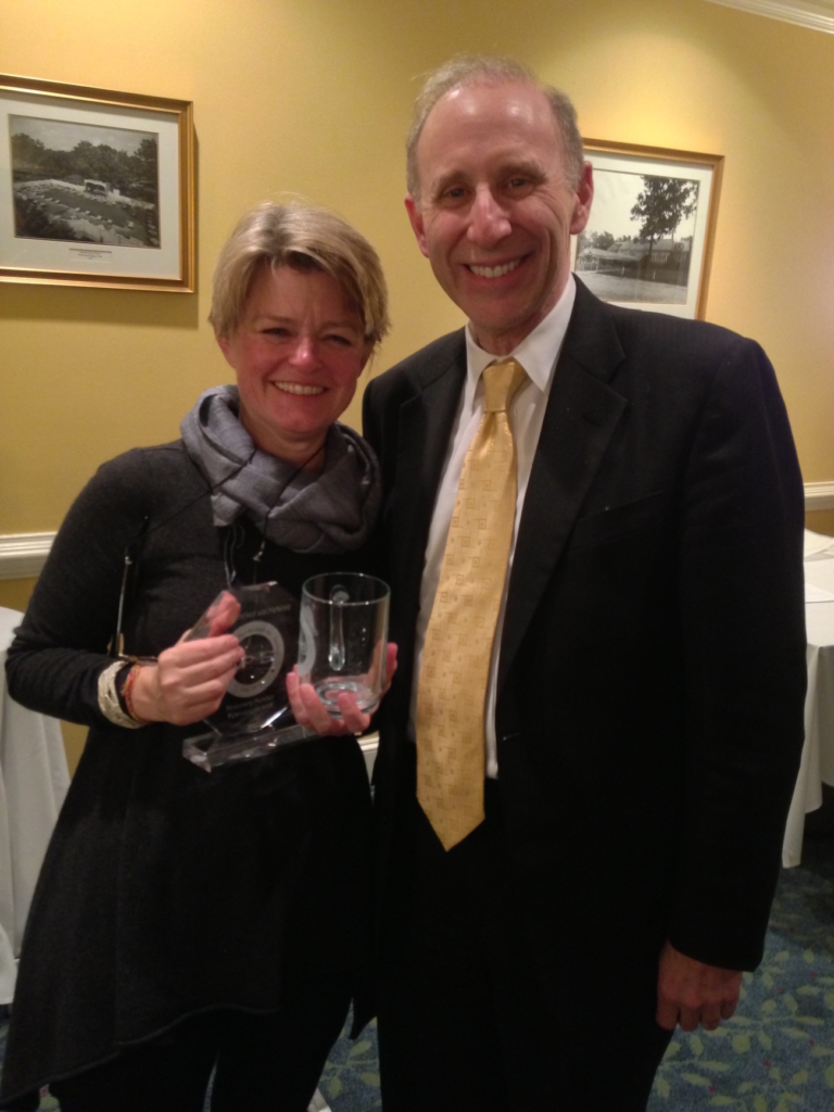 Dr. Cornelia Lischewski with Virginia Psychoanalytic Society's Honorary Membership and mug.