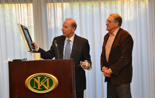 Jerry Blackman gives plaque and gavel to outgoing President Dan Kowler