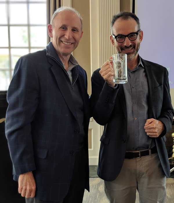 Dr. Jerome Blackman presented the honorary VPsaS mug to Dr. Nathan Kravis at the October 2018 meeting
