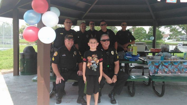Police Crash Autistic Boy's Birthday Party…To Help Him Celebrate It