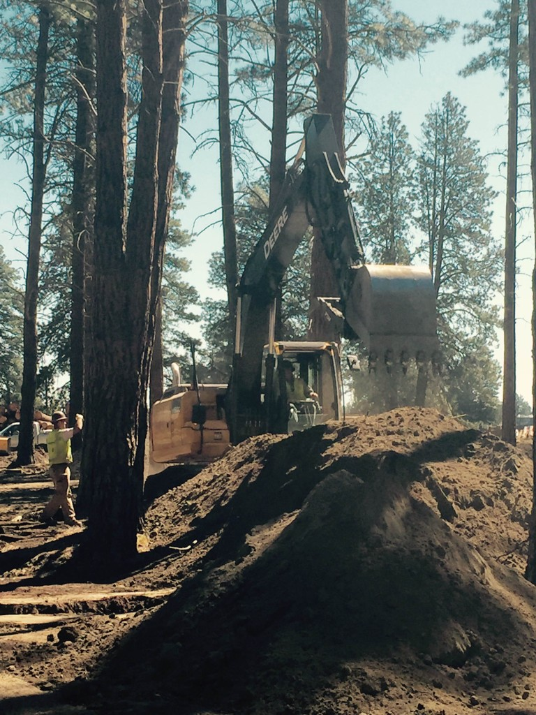 The Hitachi & John Deere excavators hard at work at the FivePine Lodge project in Sisters, Oregon.  Today the crew was digging trenches for the sewer line. Working amongst the pine trees can't be all bad.