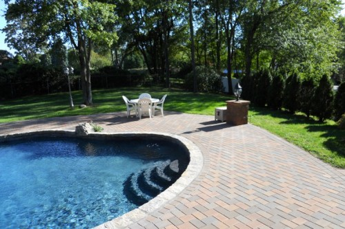 Create a Backyard Staycation with a Stone Pool Surround