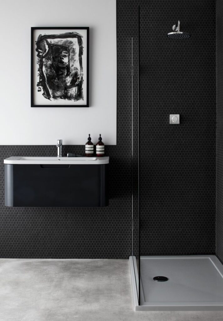 Black bathroom with a splash panel new to this decade