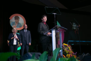 Ryan Regan accepting the award for Youth Leadership.