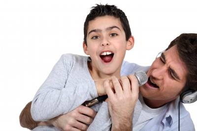 Boy and father with microphone