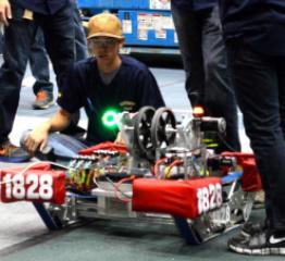 """Team members test """"The Kurgan"""" robot."""