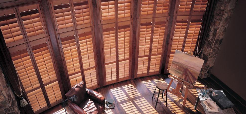 Custom shutter plantation shutters Hunter Douglas Wooden Shutters Heritance living room shutters light filtering plantation shutters