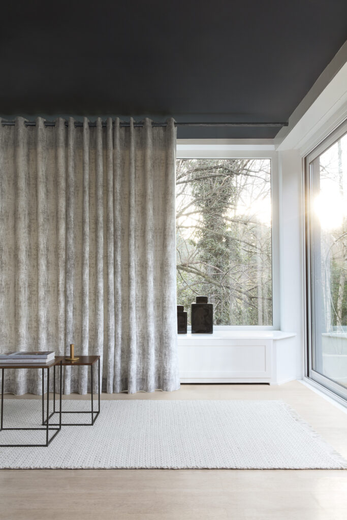 Drapery over a large living room window