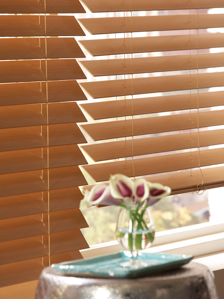 A close up on faux wood blinds
