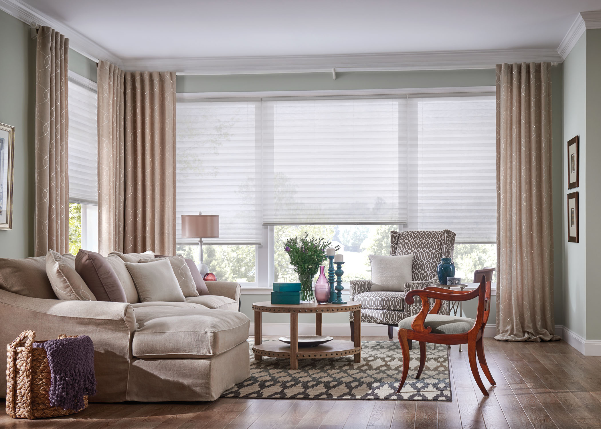 Sheer shades being shown in the living room