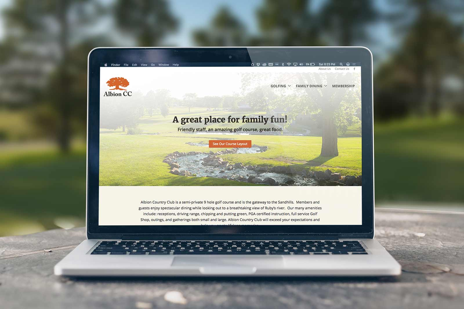 Albion Country Club - Home page shown on Macbook
