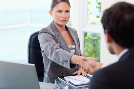 showing up, woman shaking hands with executive