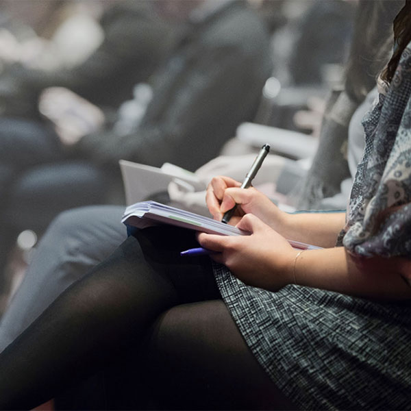 A group of people taking notes on the HIMSS19 Topic Tracks