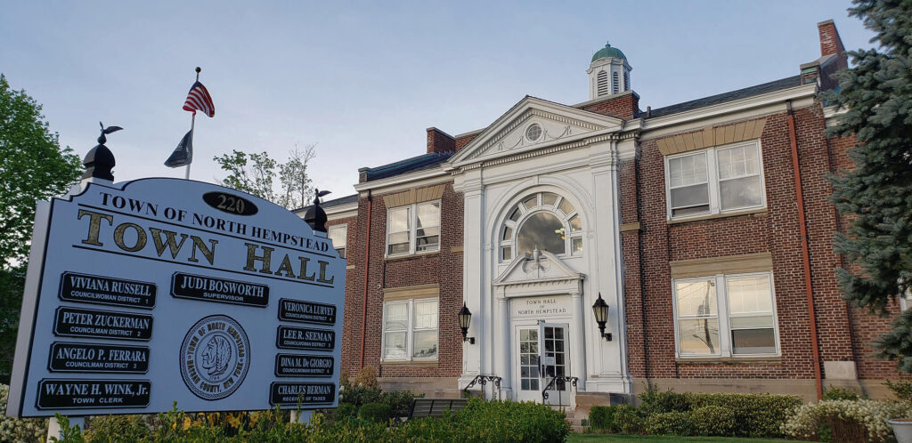 North Hempstead's Town Hall main entrance with sign in foreground identifying the building.