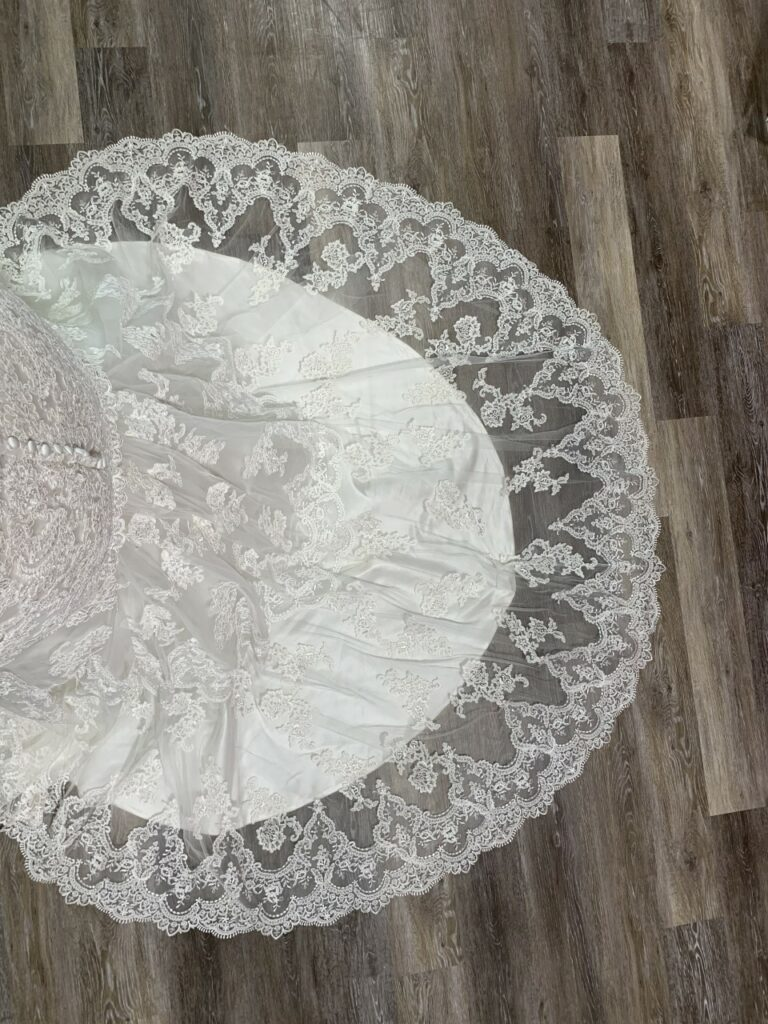 lace train on plus size wedding dress