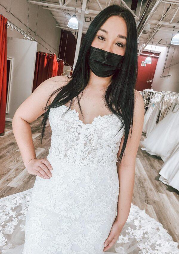 bride wearing mask in discount designer wedding dress oakland california