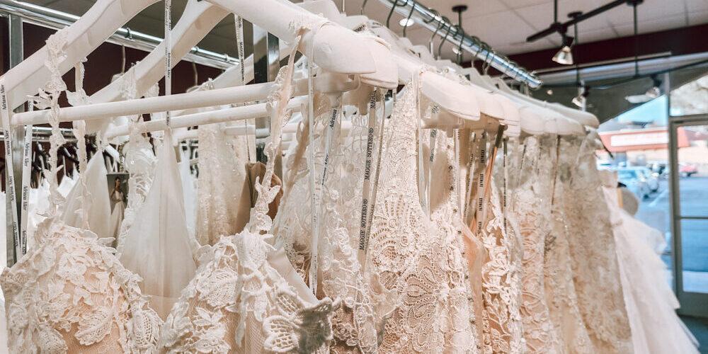 rack of off the rack designer wedding dresses near orange county california