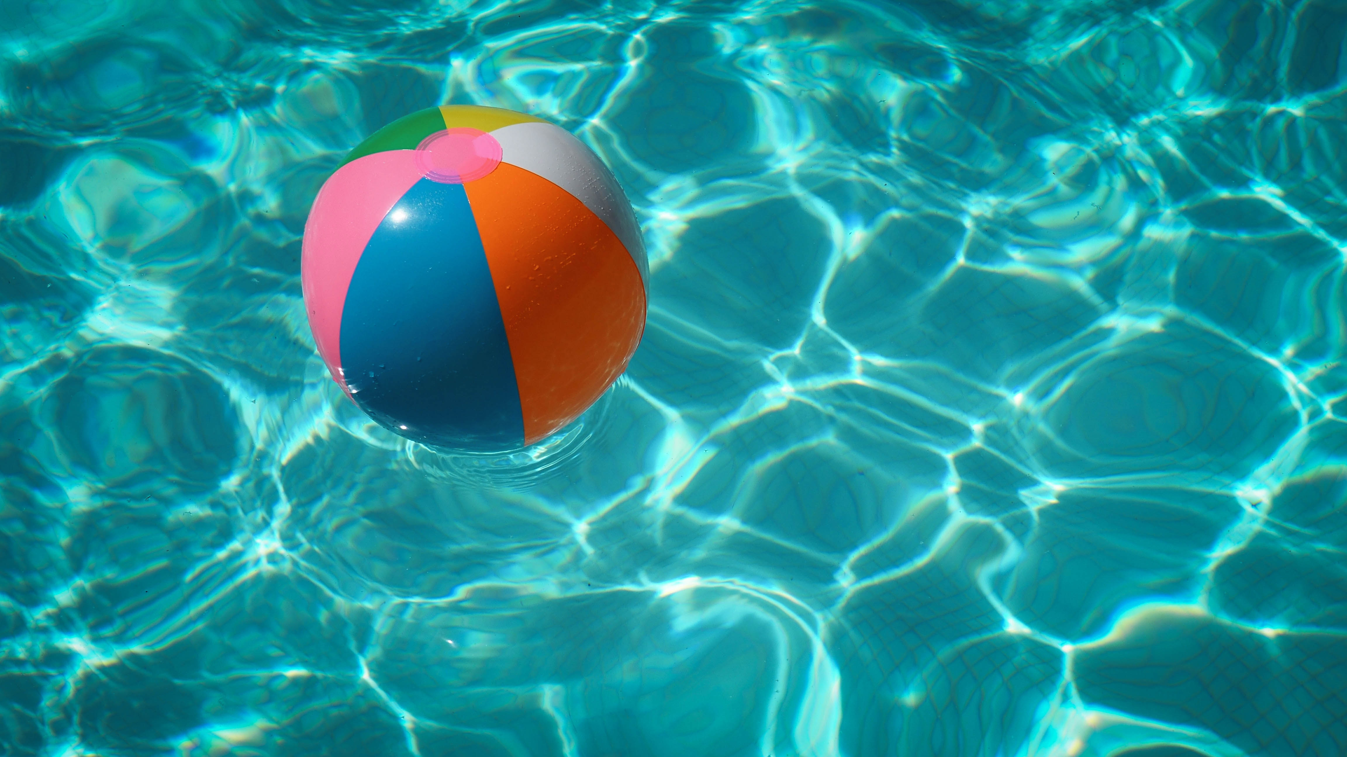 Beach ball floating in a pool
