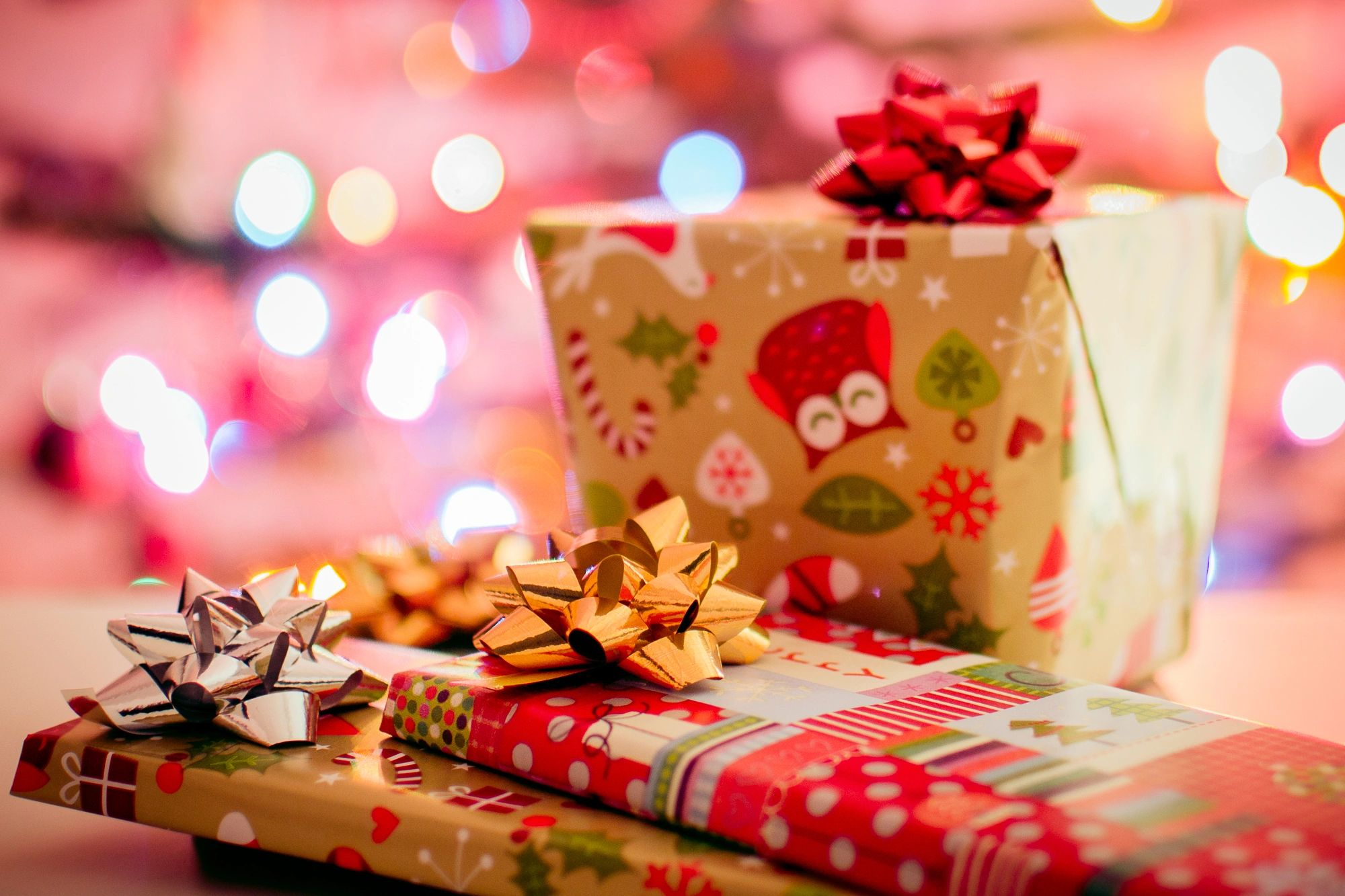 Christmas gifts left under a tree