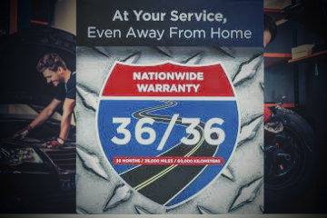 """nationwide warranty sign. it says """"at your service, even away from home""""."""