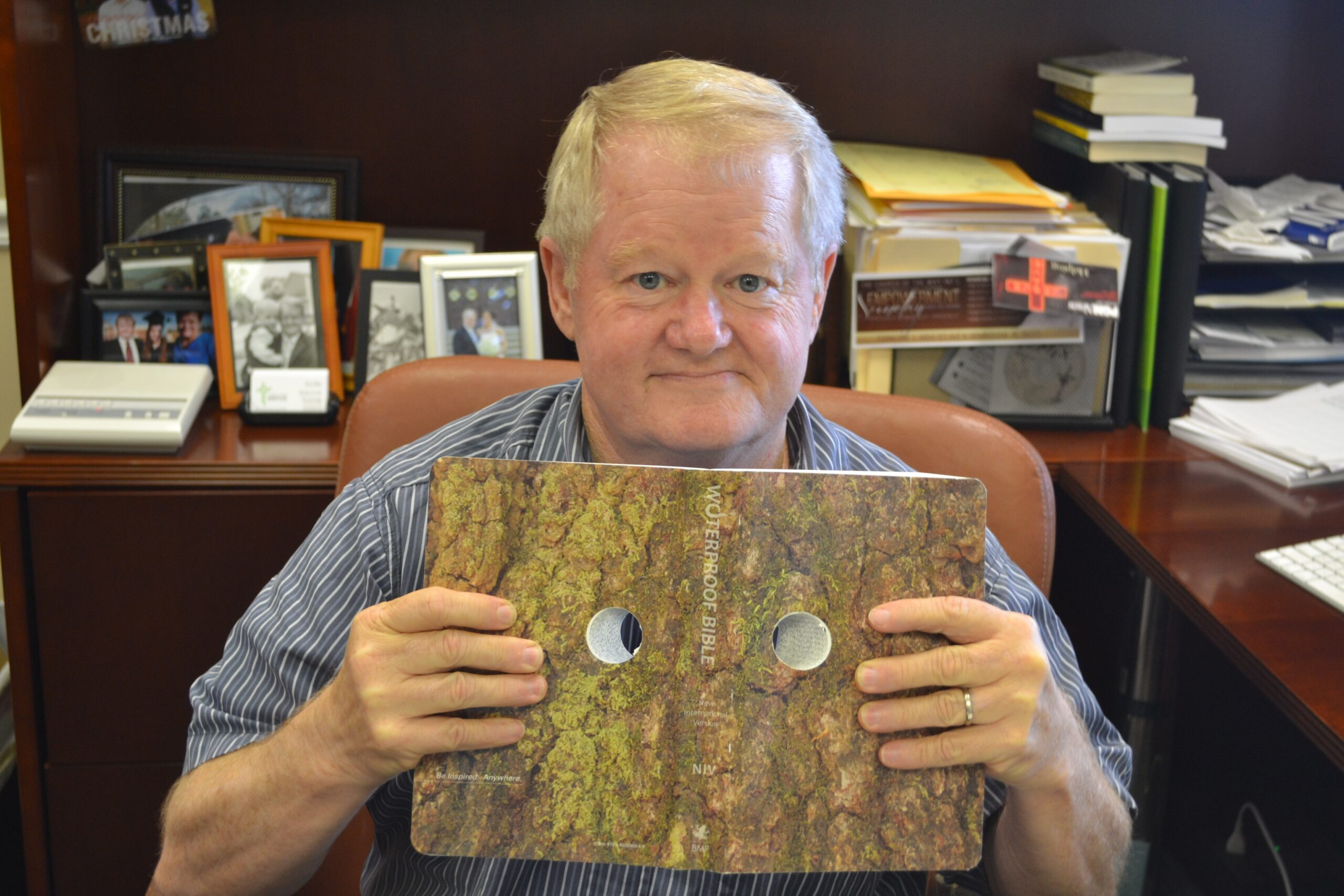 Tracy uses this Bible with eye-holes drilled in to remind him to look at the world through the lens of scripture and not through his own eyes.