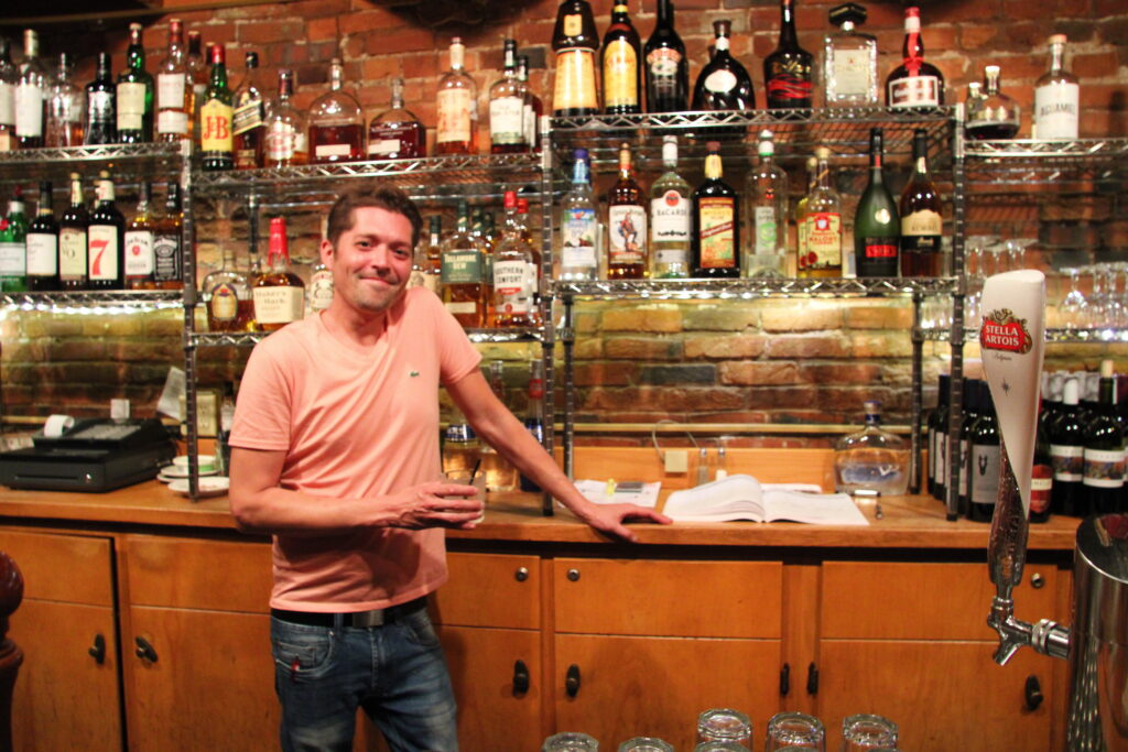 Carl standing behind the bar at Robbie Bar & Grill