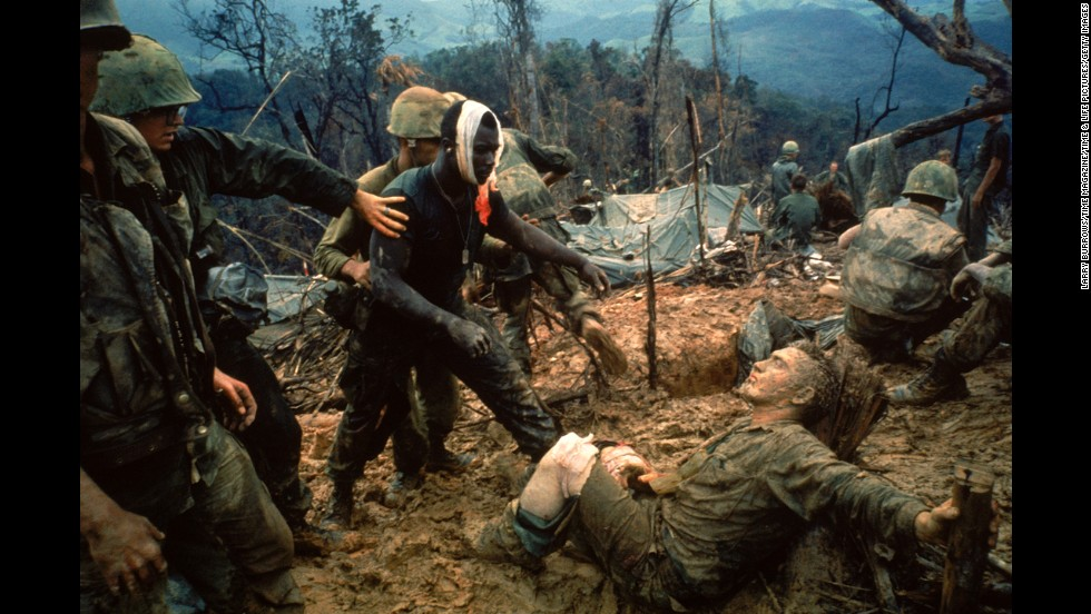 VIET NAM - 1966: Wounded Marine Gunnery Sgt. Jeremiah Purdie (C) being led past stricken comrade after fierce firefight for control of Hill 484 south of the DMZ. (Photo by Larry Burrows/Time Magazine/Time & Life Pictures/Getty Images)
