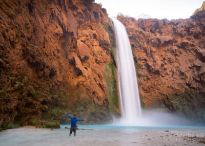 Posing in front of Mooney Falls from the side.