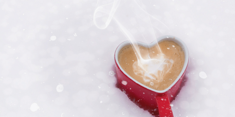 Ann Peck says Coffee shows love with a red heart shaped coffee much