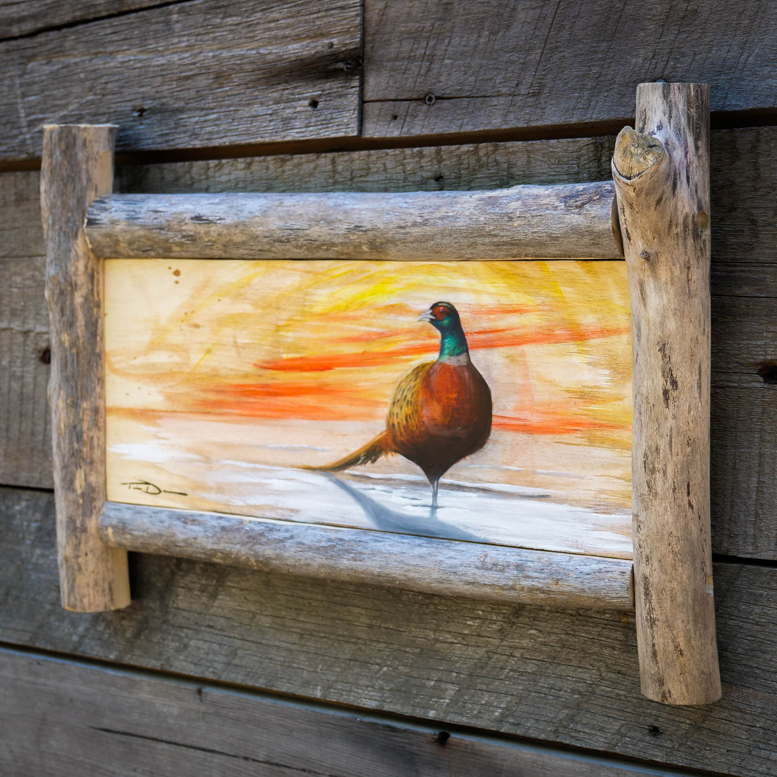 Pierre Pheasant - Original oil painting by wildlife artist Timothy Davison of the Davison Art Company featuring a ringneck pheasant standing in the snow at sunset. This colorful painting appears to come off the surface, revealing the wood grain beneath. Framed with a custom driftwood frame. © COPYRIGHT TIMOTHY DAVISON
