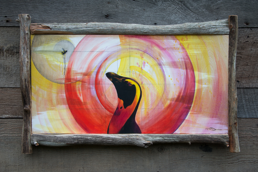 The Birds and the Bees - Original oil painting by wildlife artist Timothy Davison of the Davison Art Company featuring an African penguin looking up at a bumble bee, surrounded by circles of color - representing the circle of life thanks to the birds and the bees. This colorful painting appears to come off the surface, revealing the wood grain beneath. Framed with a custom driftwood frame. © COPYRIGHT TIMOTHY DAVISON