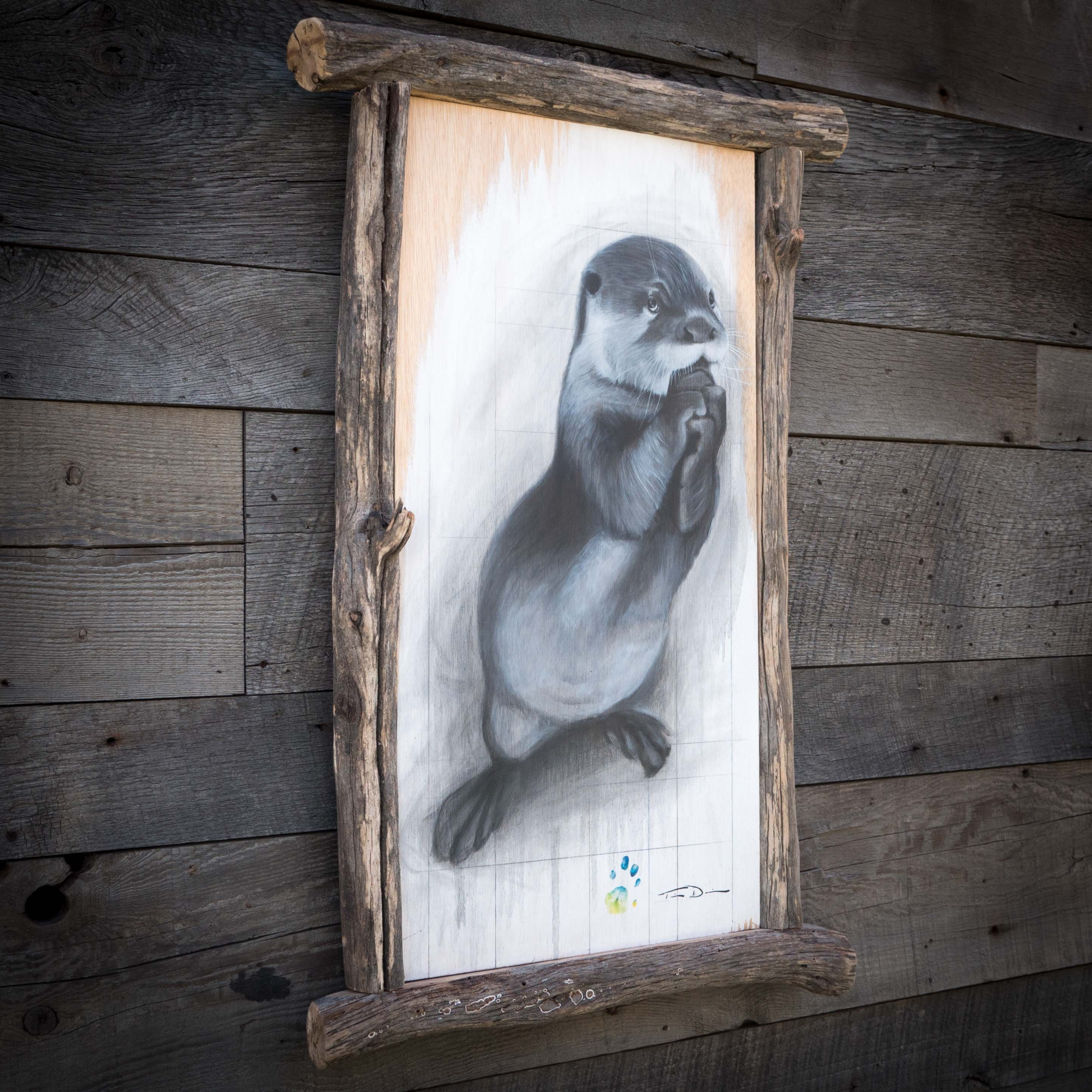 Otter-Graph - Original oil painting by wildlife artist Timothy Davison of the Davison Art Company featuring an Asian small clawed otter in black and white. This one-of-a-kind collaboration painting has real otter footprints in the background. This painting appears to come off the surface, revealing the wood grain below. Framed with a custom driftwood frame. © COPYRIGHT TIMOTHY DAVISON