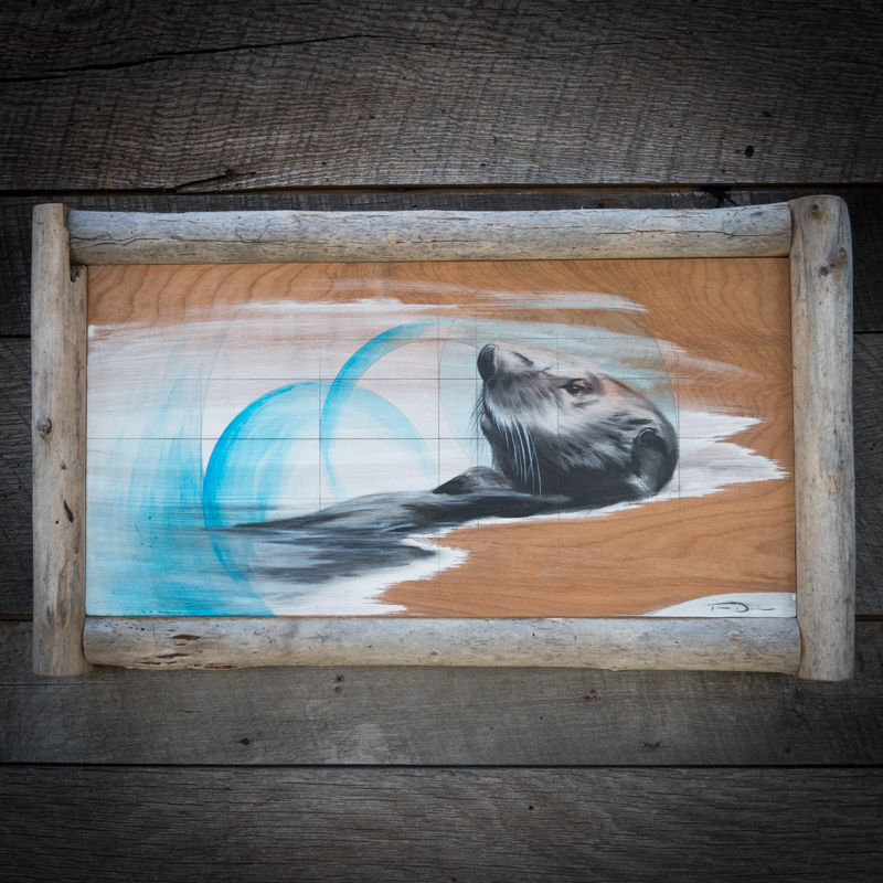 Blue Otter - Original oil painting by wildlife artist Timothy Davison of the Davison Art Company featuring a sea otter, swimming on the surface surrounded by blue circles, representing the different worlds in which they live above and below the surface/ This painting appears to come off the surface, revealing the wood grain below. Framed with a custom driftwood frame. © COPYRIGHT TIMOTHY DAVISON