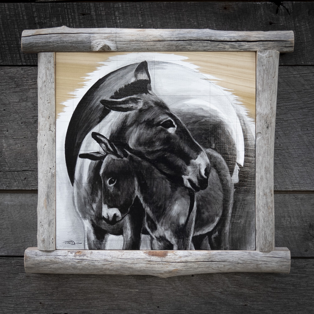 Donkey Dad - Original oil painting by wildlife artist Timothy Davison of the Davison Art Company featuring a donkey father comforts his foal by resting his head on their shoulder. This black and white painting comes off the wood surface, revealing the wood grain below. Framed with a custom driftwood frame. © COPYRIGHT TIMOTHY DAVISON