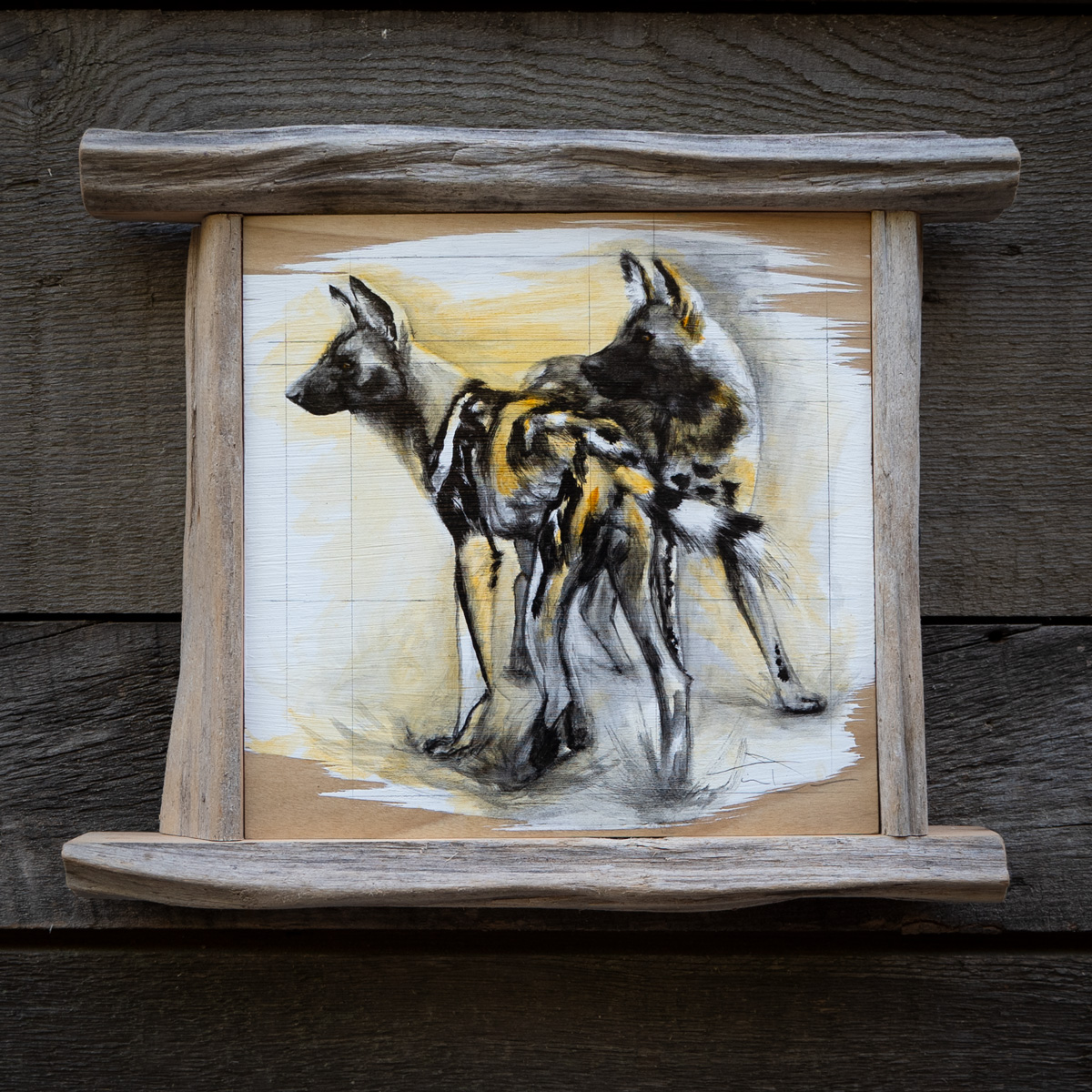Painted Wolves Painted - Original oil painting by wildlife artist Timothy Tim Davison of the Davison Art Company featuring a pair of African painted wolves, also known as painted dogs or wild dogs, framed in a custom driftwood frame. © COPYRIGHT TIMOTHY DAVISON