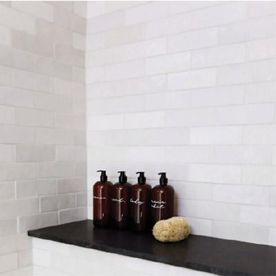 a white subway tile style shower tile