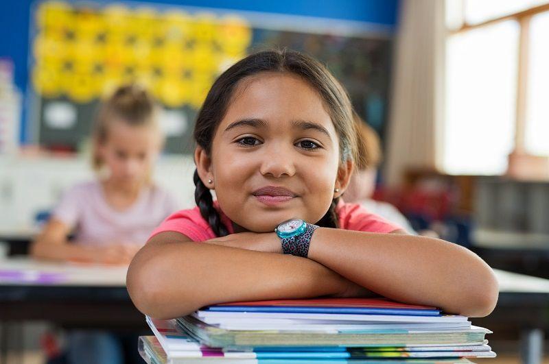 Hispanic-girl-with-chin-on-books-cm