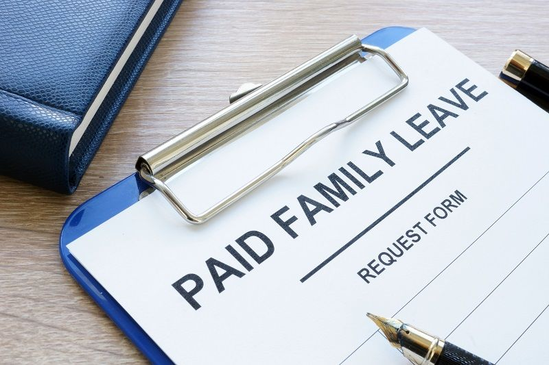 Paid-family-leave-form-in-clipboard-and-note-pad.-cm