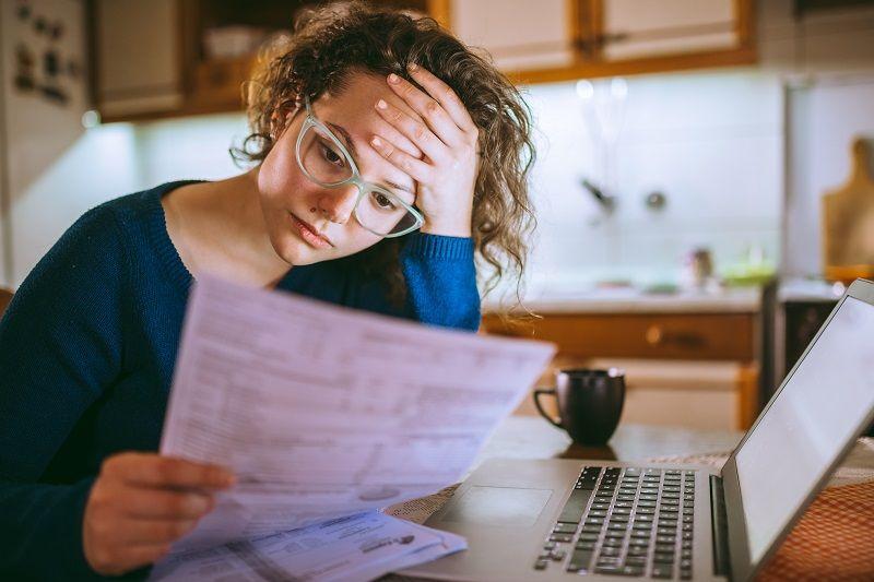 Woman-going-through-bills,-looking-worried-cm