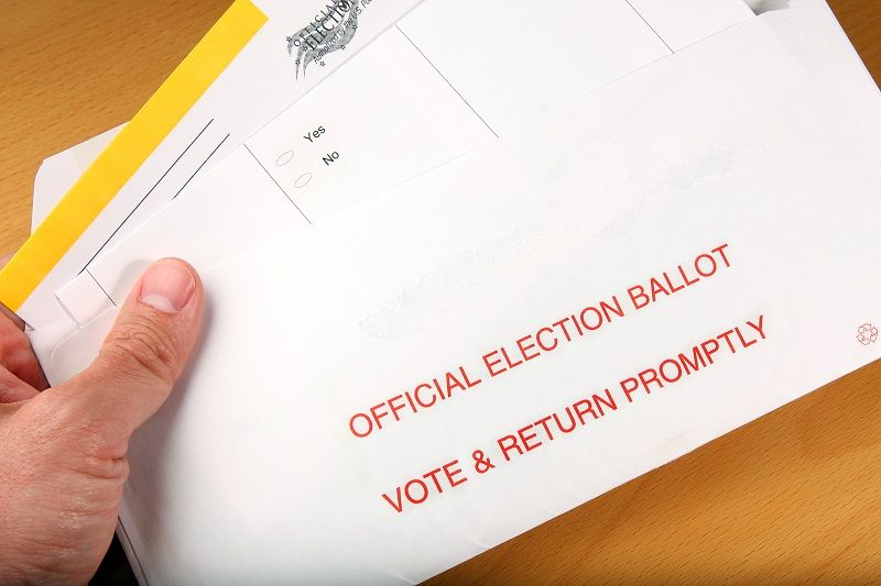 Man-opening-mail-in-ballot-cm