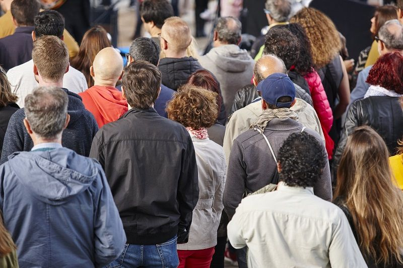 Group-of-people-listening-on-the-street.-Crowded-background-cm