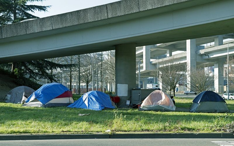 Homeless-encampment-below-freeway-in-Seattle-WA-cm