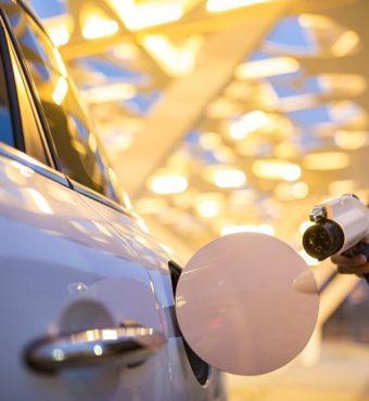 Man-charging-electric-car-cm